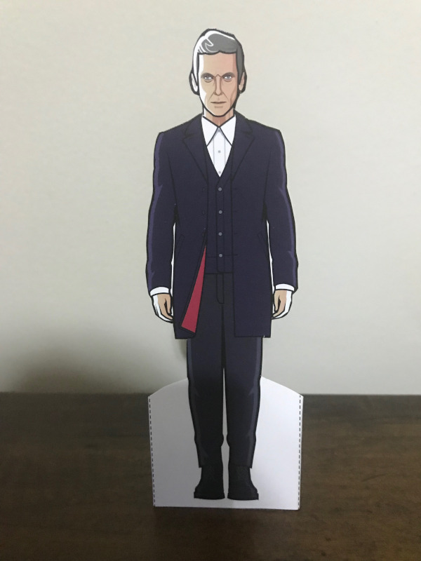 Twelfth Doctor paper doll in his original smarter outfit.  A flash of red lining is visible on the jacket.