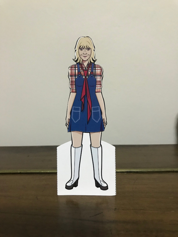 Jo Grant paper doll wearing a check shirt, denim mini-dress and knee-length white boots.