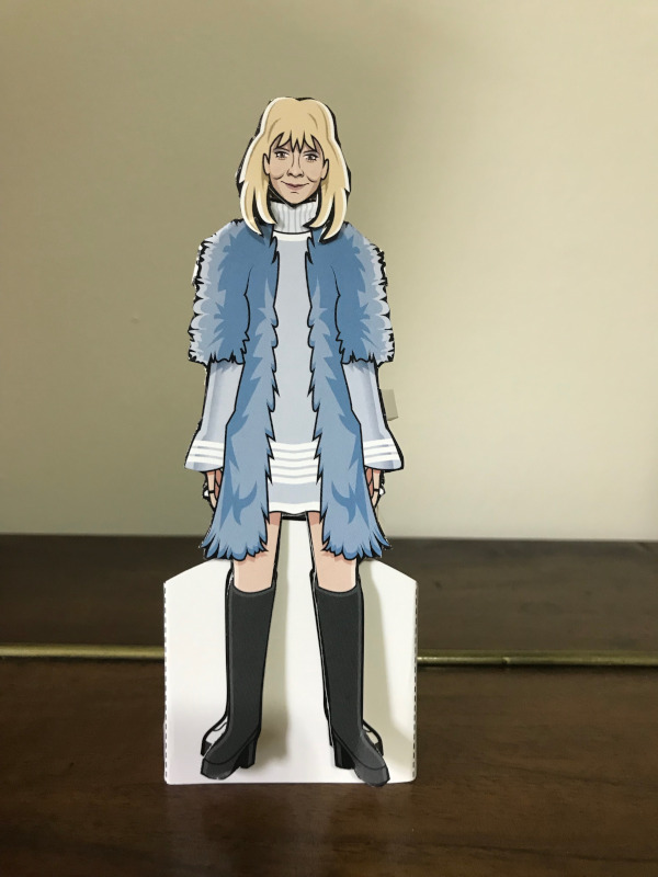 Paper Doll of Jo Grant in a blue mini-dress, big fluffy blue fur coat and thigh length boots.