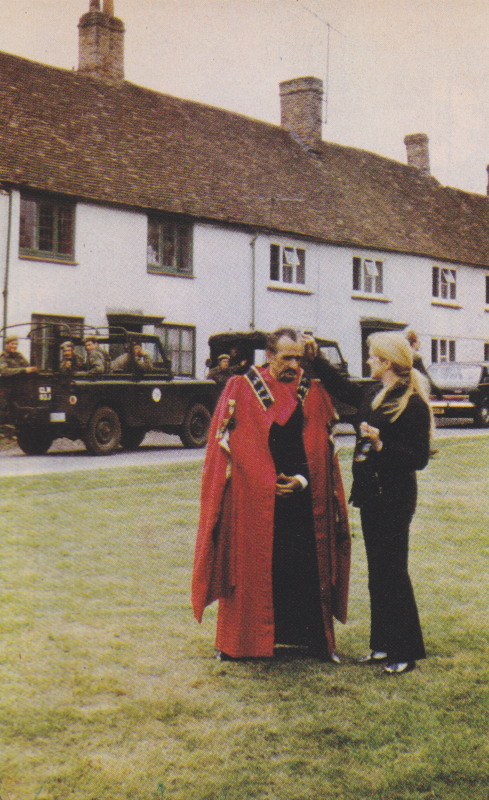 The village from the Daemons.  Roger Delgado in his red Magister robes is having his make-up touched up.
