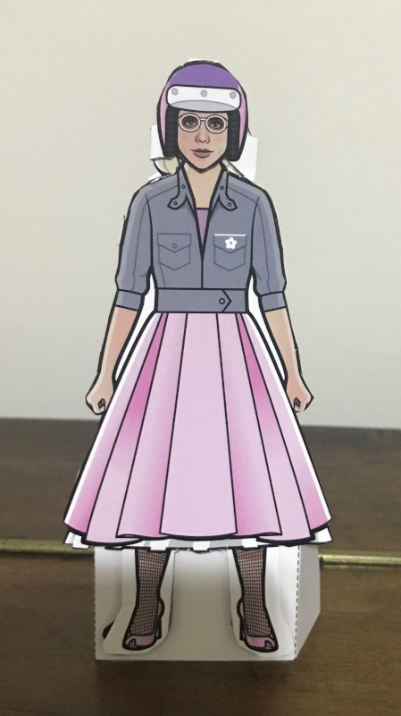 Paper Rose Doll in her pink 1950s outfit with motorcycle helmet.