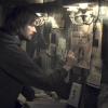 Jonas, older version, looking at the picture wall from Dark.