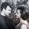 Ian and Barbara looking at each other and smiling.  Slight colour wash.