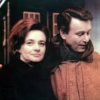 Color image of Ian and Barbara standing outside the Tardis from Marco Polo.