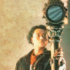 Change Lee from Doctor Who the TV Movie holding a big mirror on a stick