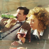 Eleven and River drinking wine.