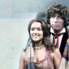 Fourth Doctor and Leela from a publicity still, his scarf draped over her shoulder