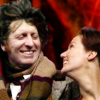 Fourth Doctor and Leela looking at each other and smiling.