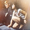 Tegan and Turlough crouched down
