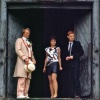 Tegan, Turlough and the Fifth Doctor standing in a doorway
