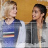 Jodie Whitaker and Mandip Gill wearing their costumes and looking at each other - white framing around the edge